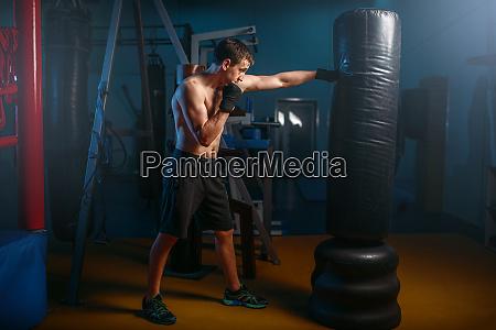 man in black handwraps exercises with