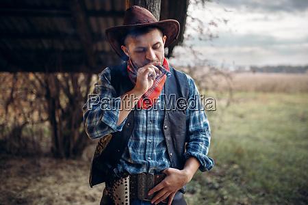 brutal, cowboy, smokes, a, cigar, , wild - 28061843