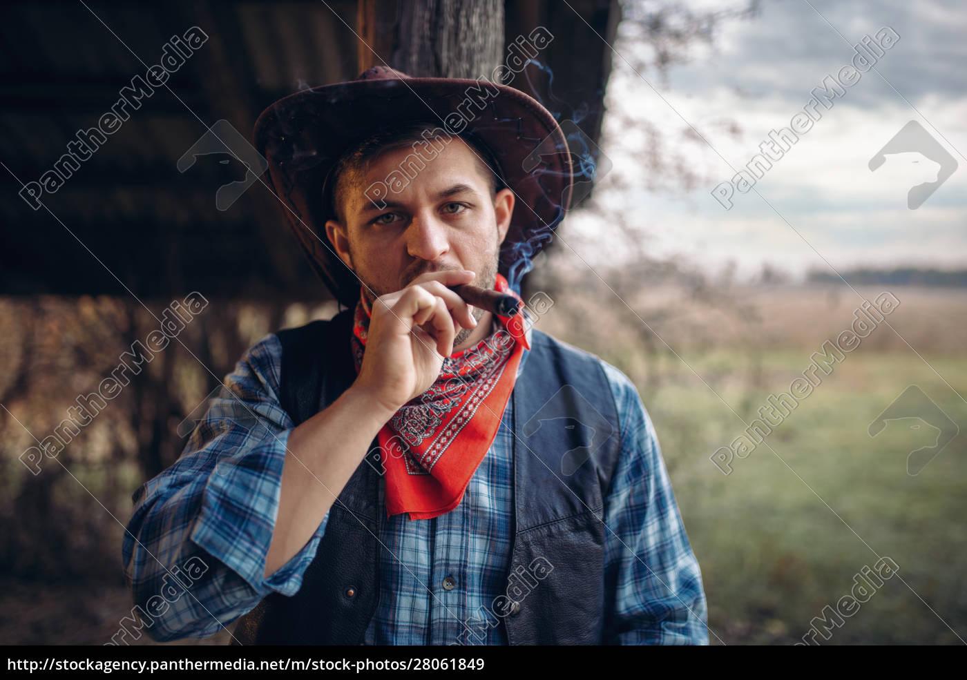 brutal, cowboy, smokes, a, cigar, , wild - 28061849