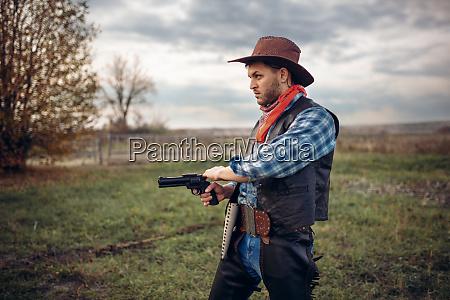 brutal, cowboy, with, revolver, , gunfight, on - 28061804