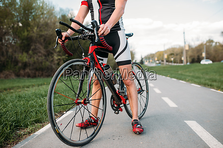 bycyclist, in, helmet, and, sportswear, on - 28061495