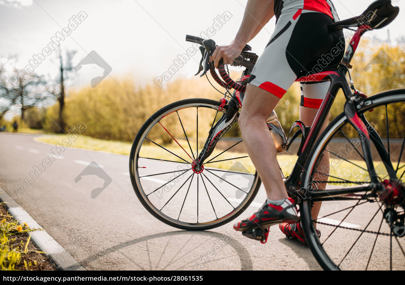 bycyclist, in, helmet, and, sportswear, on - 28061535