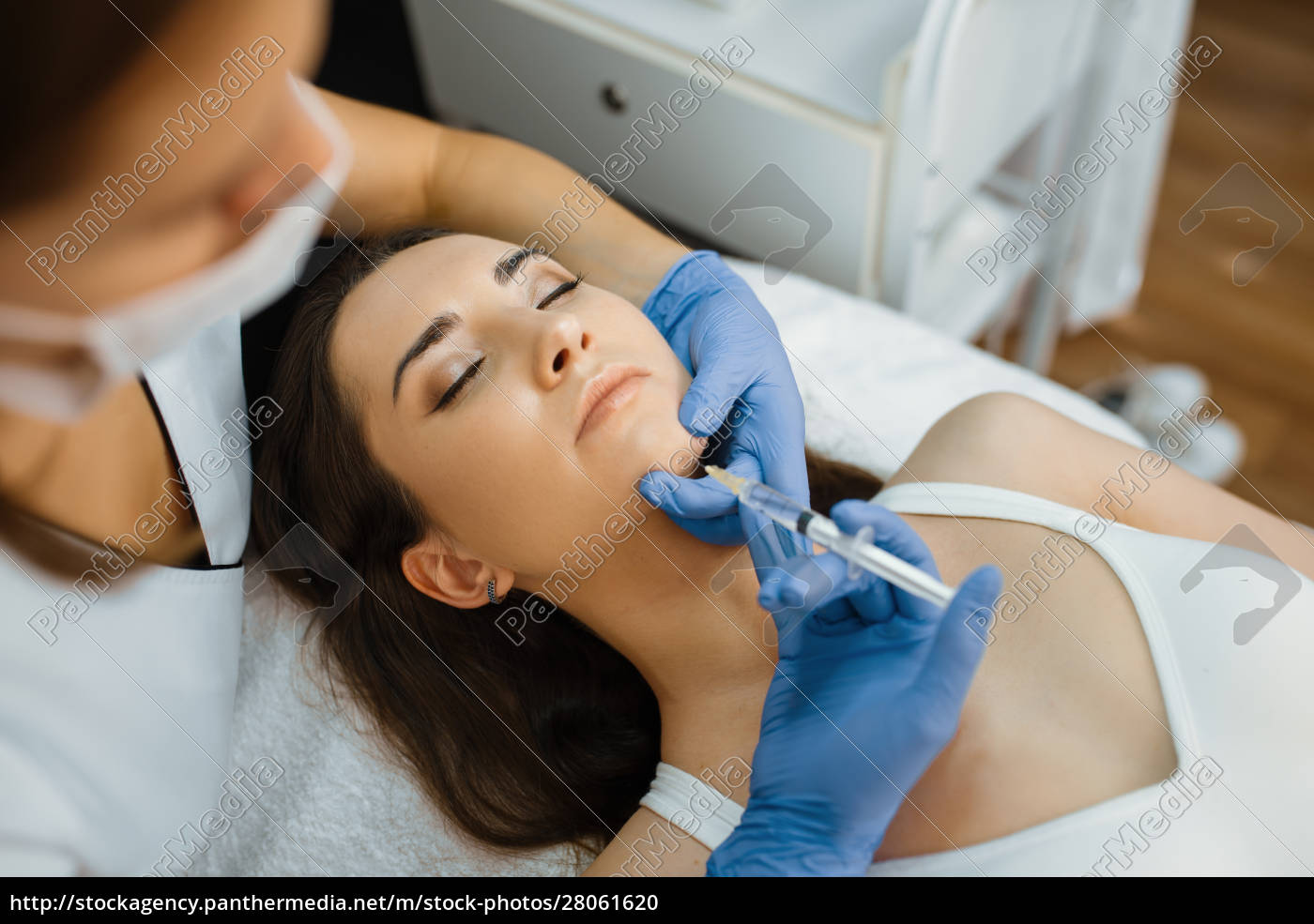 cosmetician, gives, chin, botox, injection, to - 28061620
