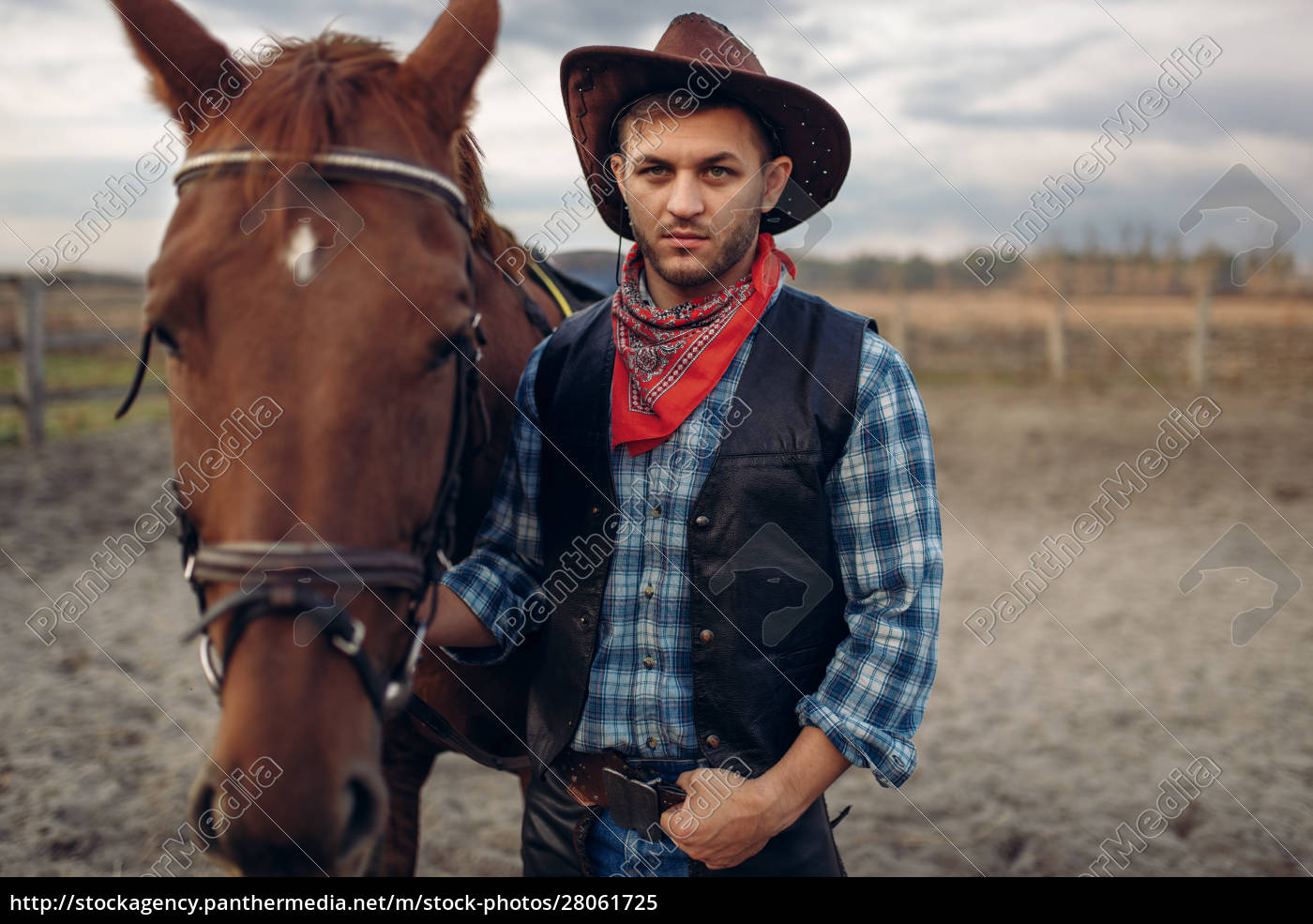 cowboy, poses, with, horse, on, texas - 28061725