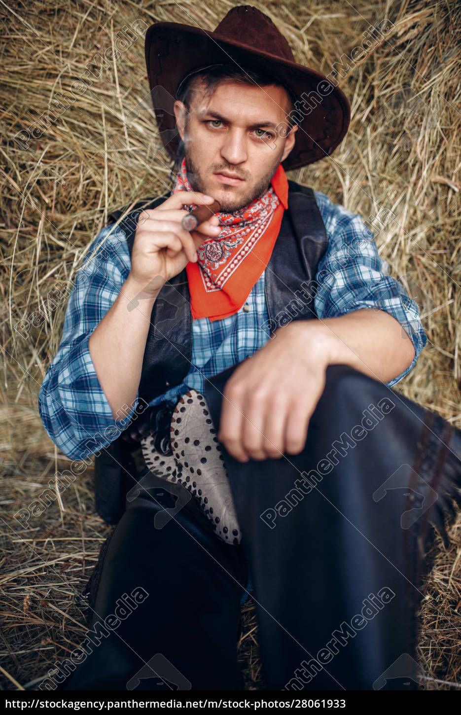 cowboy, relax, with, cigar, , haystack, on - 28061933