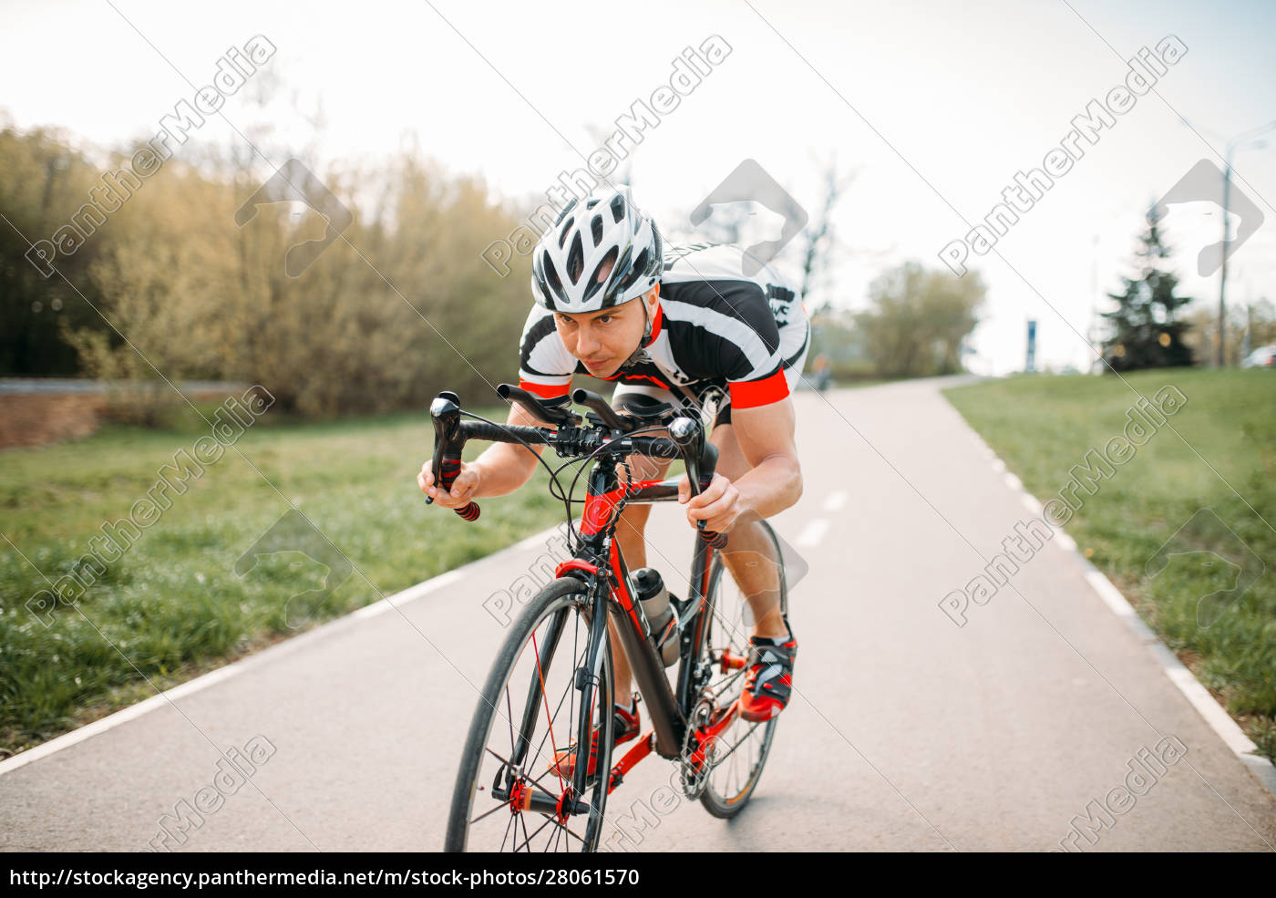 cyclist, in, helmet, and, sportswear, , bicycle - 28061570
