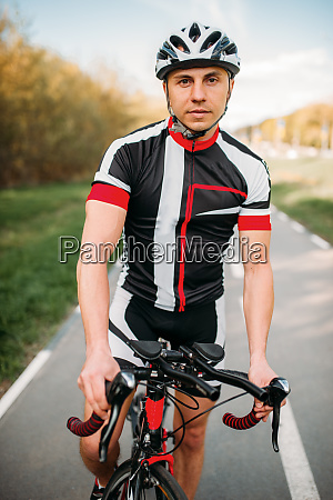 cyclist, in, helmet, and, sportswear, , bicycle - 28061645