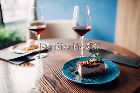 dessert, on, plate, and, red, wine - 28061519