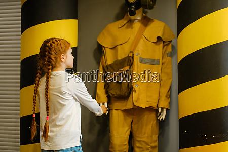 female, child, looks, on, fireman, mannequin, - 28061647