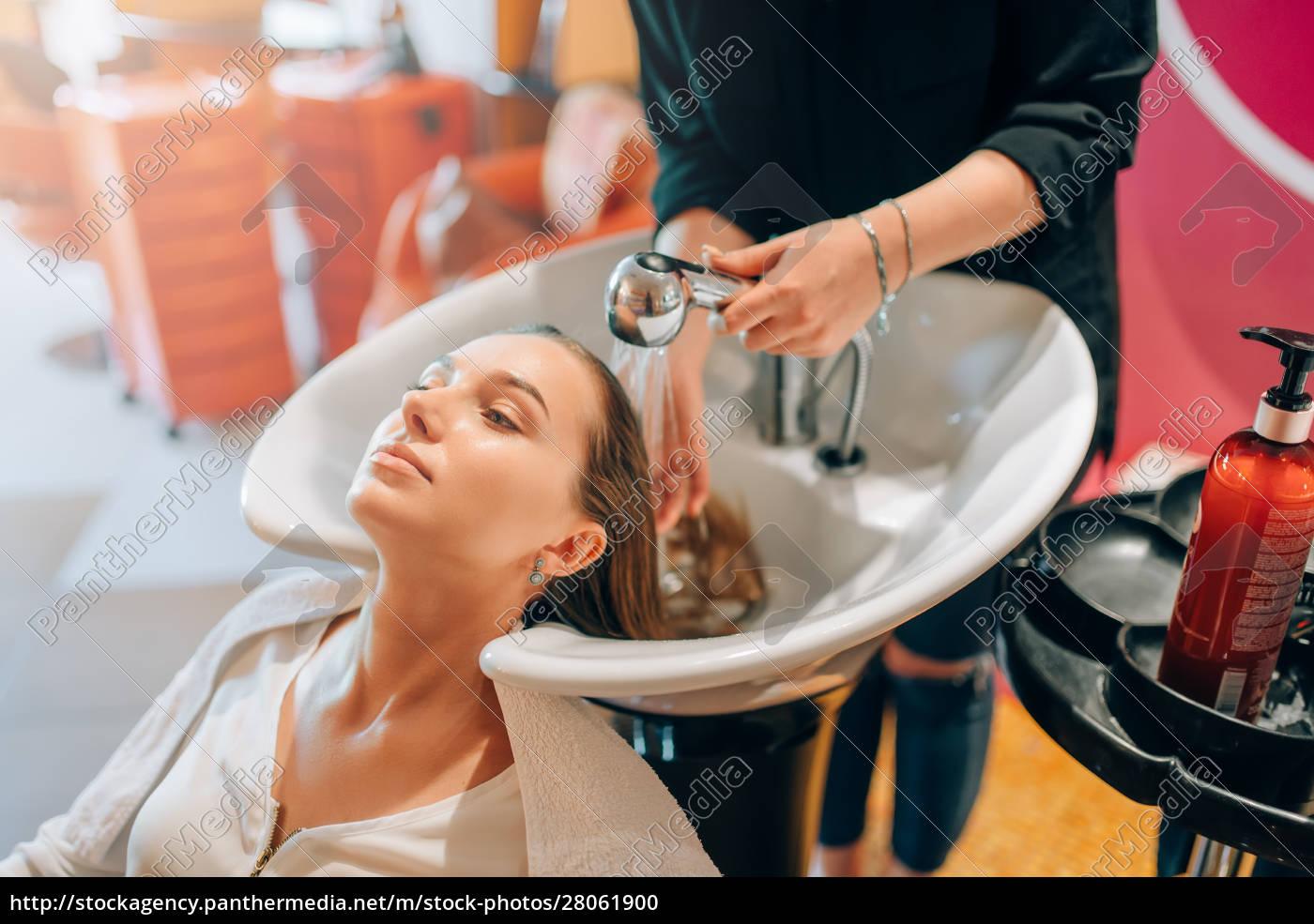 hairdresser, washes, customer, hair, in, basin - 28061900