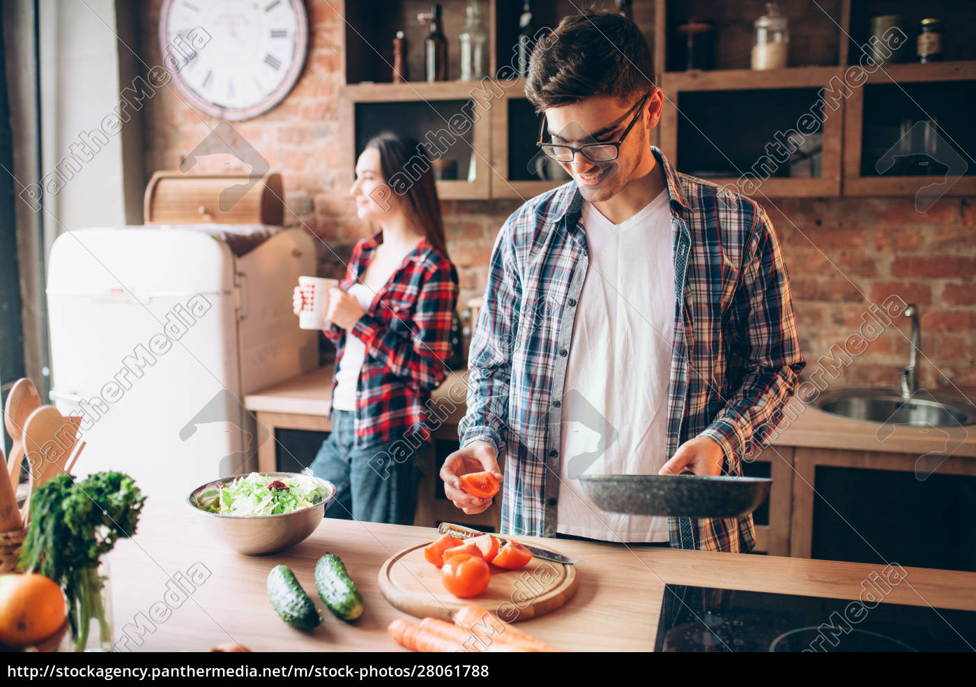 husband, hugs, wife, while, she, cooking - 28061788