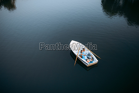 love, couple, lying, in, a, boat - 28061517