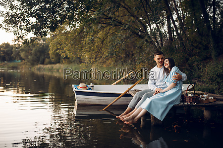 love, couple, sitting, on, the, pier - 28061475
