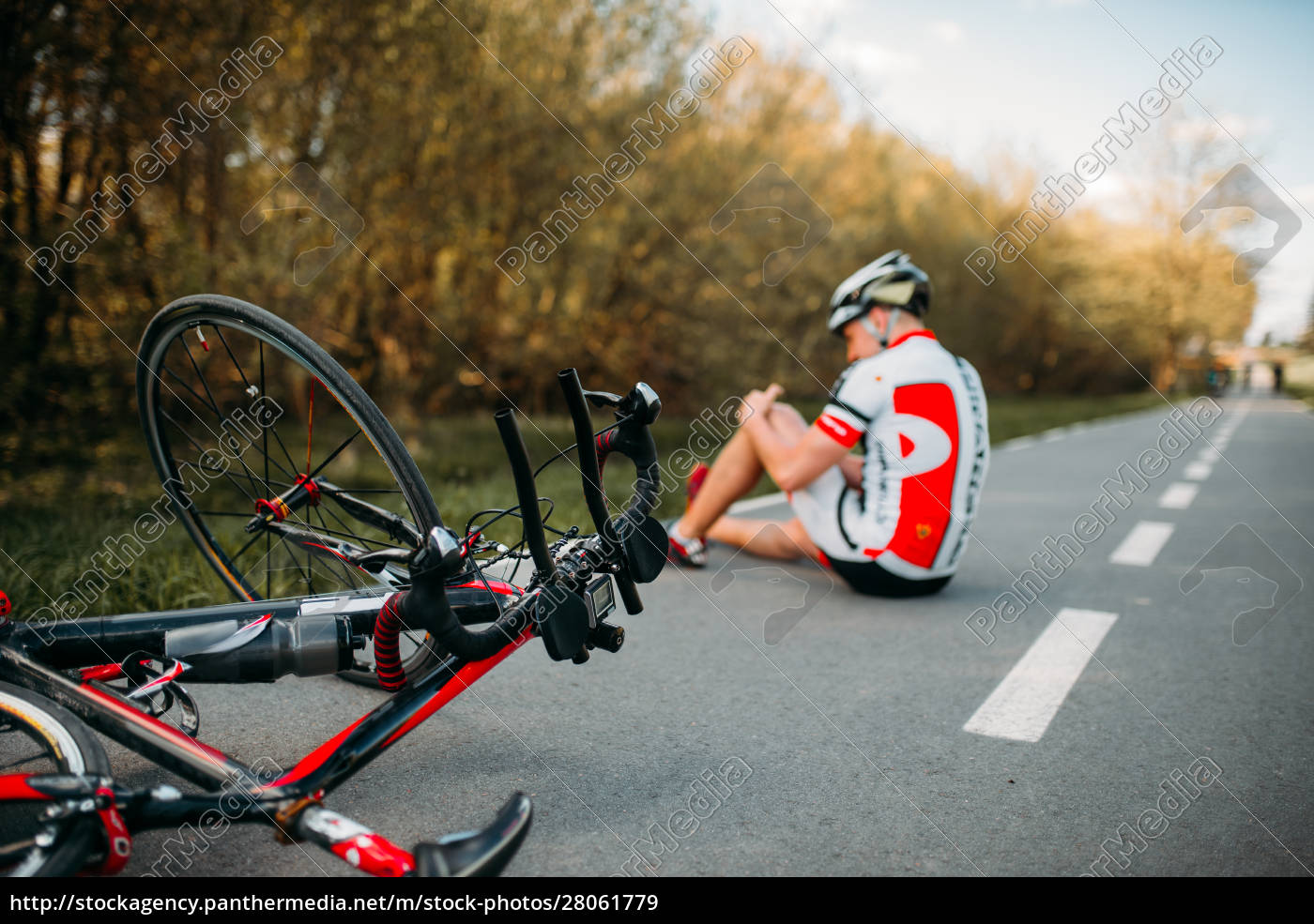 male, bycyclist, fell, off, bike, and - 28061779