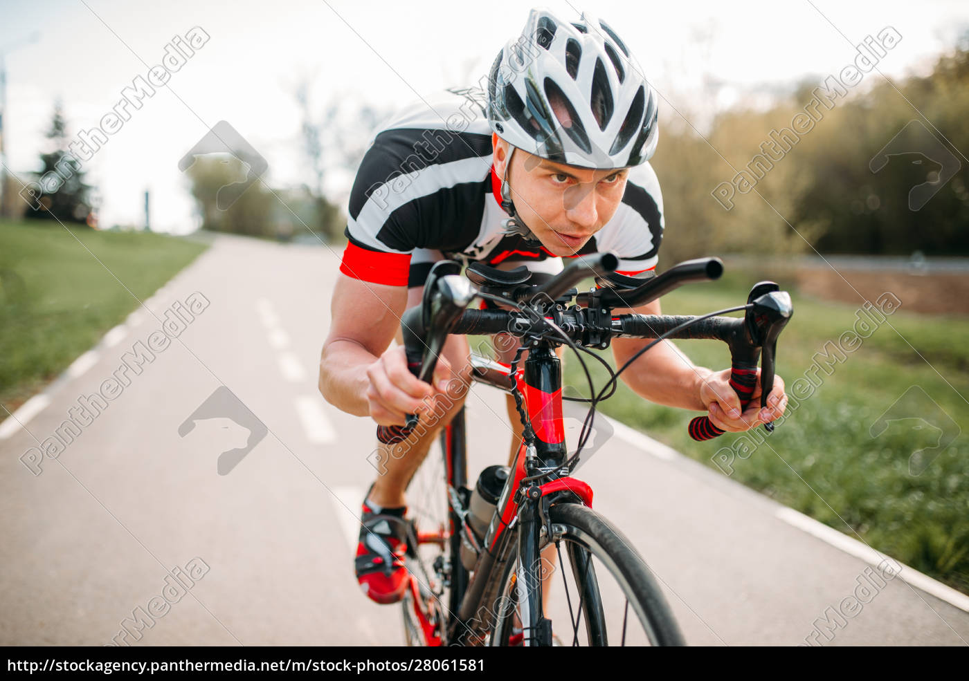 male, cyclist, rides, on, bicycle, , front - 28061581
