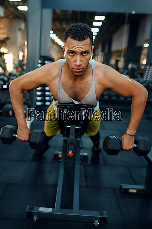 man, doing, exercise, with, dumbbells, on - 28061708
