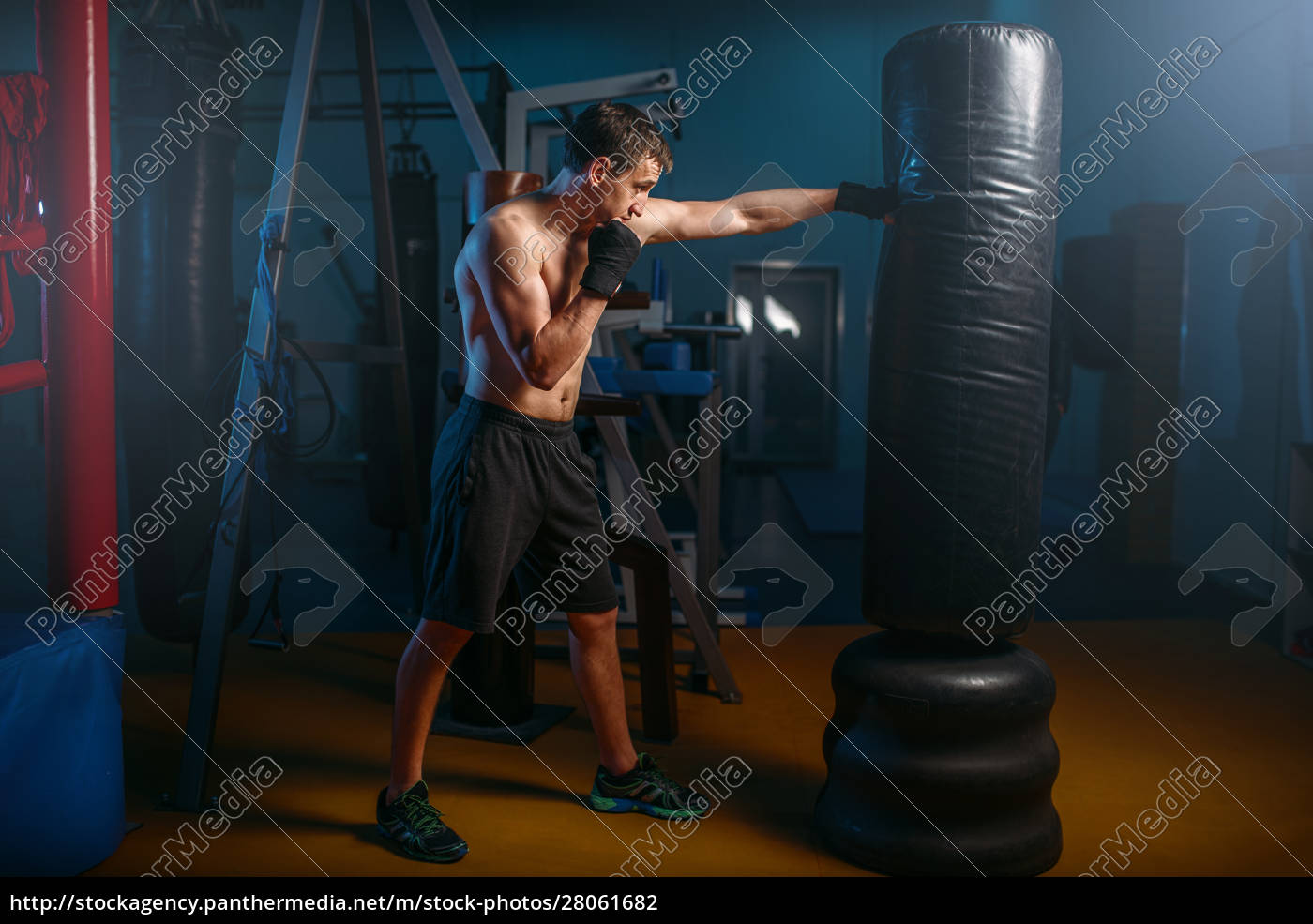 man, in, black, handwraps, exercises, with - 28061682