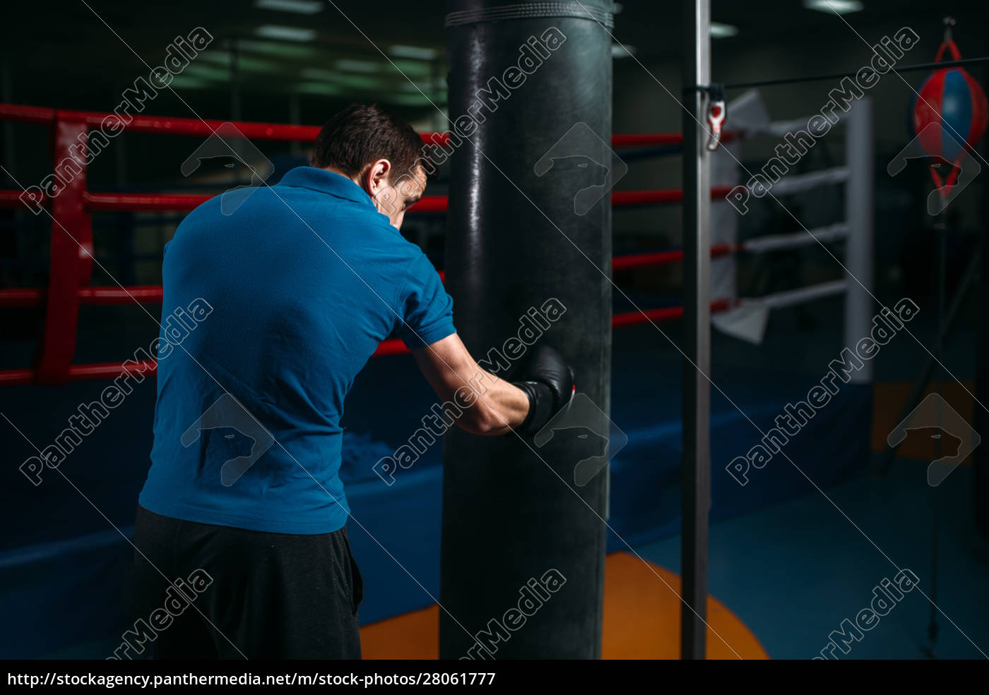 man, in, black, handwraps, exercises, with - 28061777