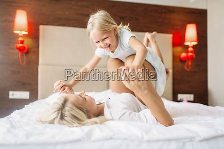 mother, and, child, plays, lying, on - 28061490