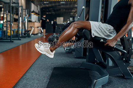 muscular, athlete, in, sportswear, at, exercise - 28061444