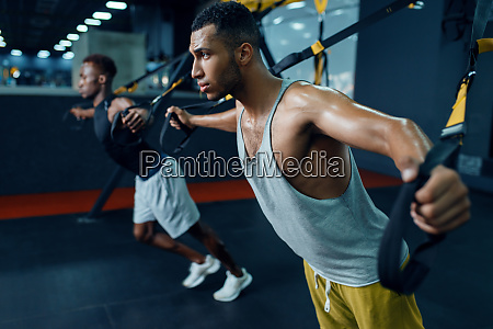 two, athletes, at, stretching, exercise, machine - 28061789