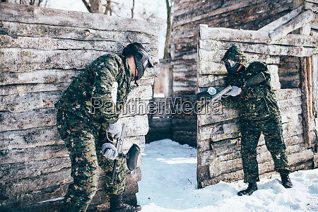 paintball battle paintballing in winter forest