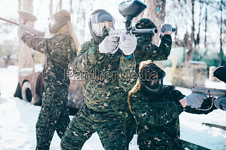 paintball players in uniform and masks