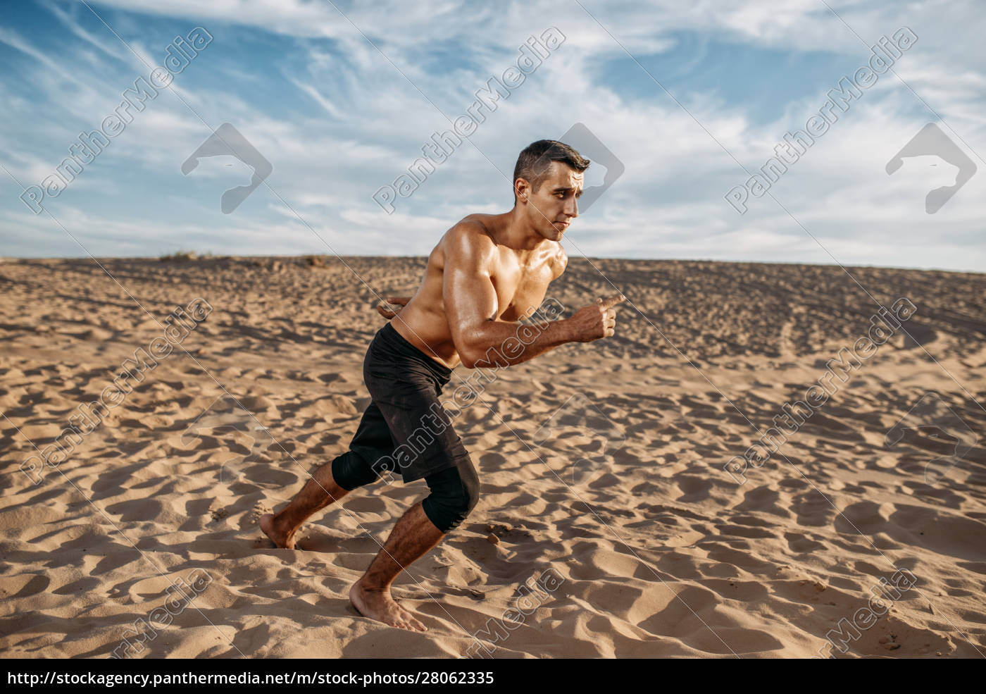 athlete, on, running, workout, in, desert - 28062335