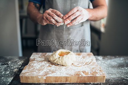 chef, hands, mix, dough, with, egg, - 28062834