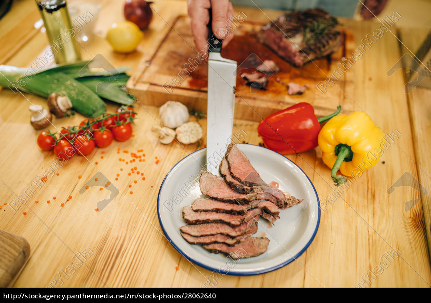 chef, with, knife, puts, roasted, meat - 28062640