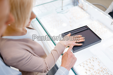couple, in, jewelry, store, , bride, trying - 28062561
