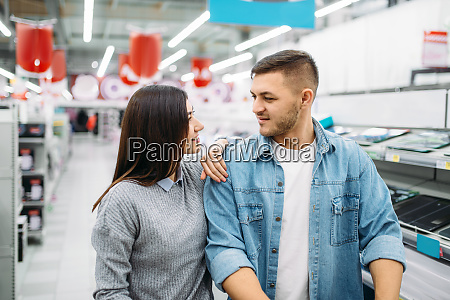 couple, looking, on, shelf, with, electric - 28062721