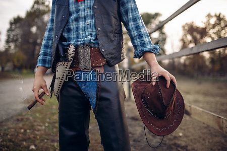 cowboy, in, leather, clothes, poses, with - 28062033
