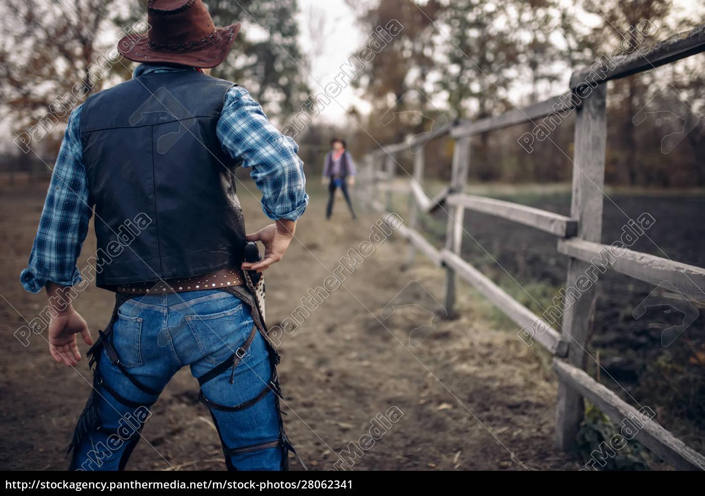 cowboy, with, gun, prepares, to, gunfight, - 28062341