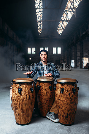 drummer, playing, on, wooden, bongo, drums, - 28062442