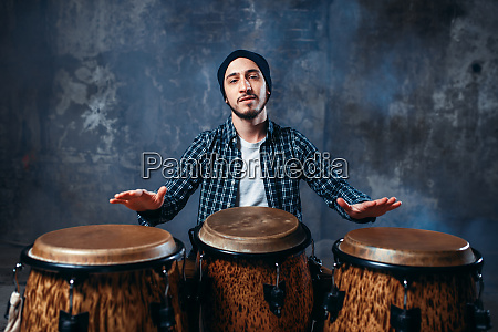 drummer, playing, on, wooden, bongo, drums, - 28062512