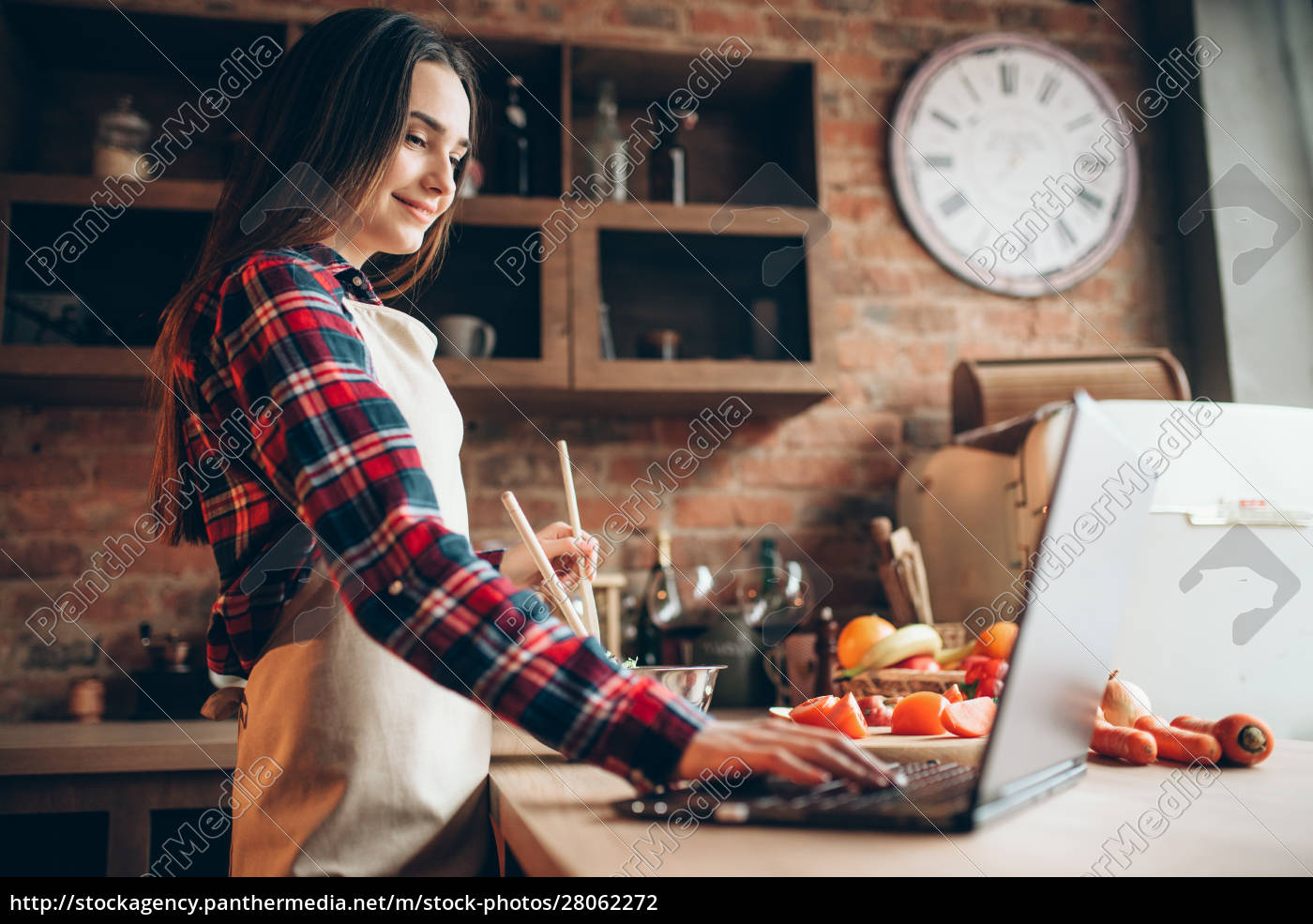 female, cook, in, apron, looks, at - 28062272