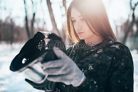 female, paintball, player, puts, on, protection - 28062706