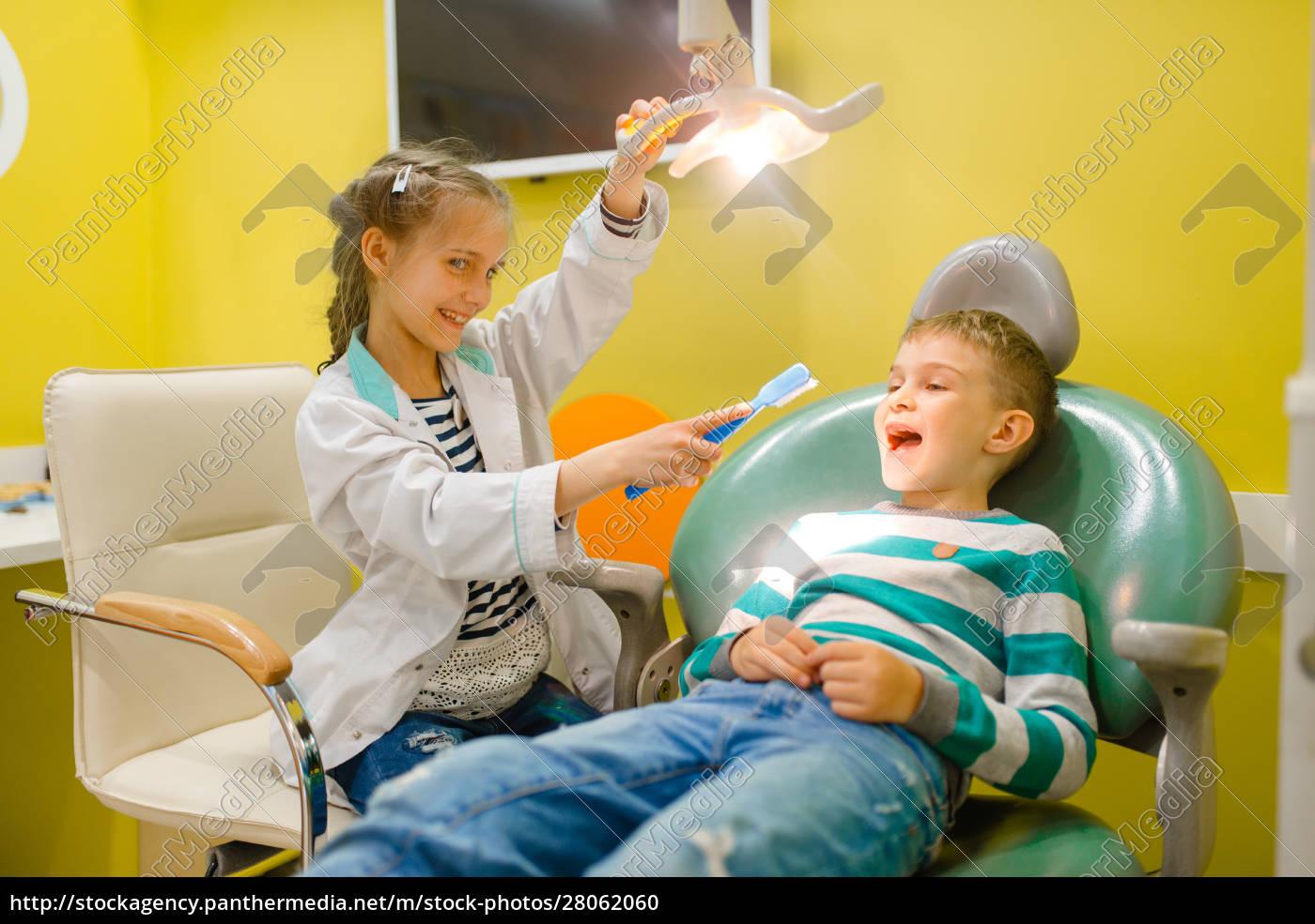 little, girl, in, uniform, playing, dentist, - 28062060
