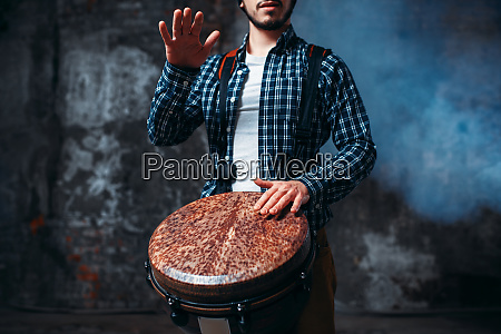 male, drummer, playing, on, wooden, drum - 28062549