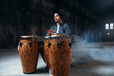 male, drummer, plays, on, wooden, drums - 28062337