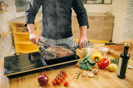 male, person, cooking, meat, in, a - 28062170