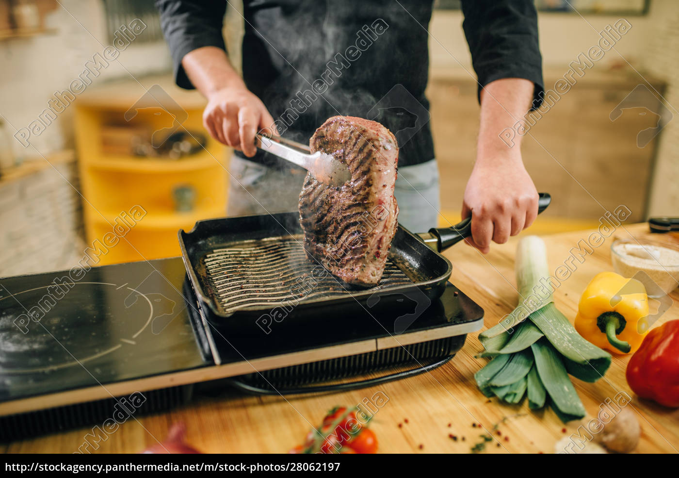 male, person, cooking, meat, in, a - 28062197