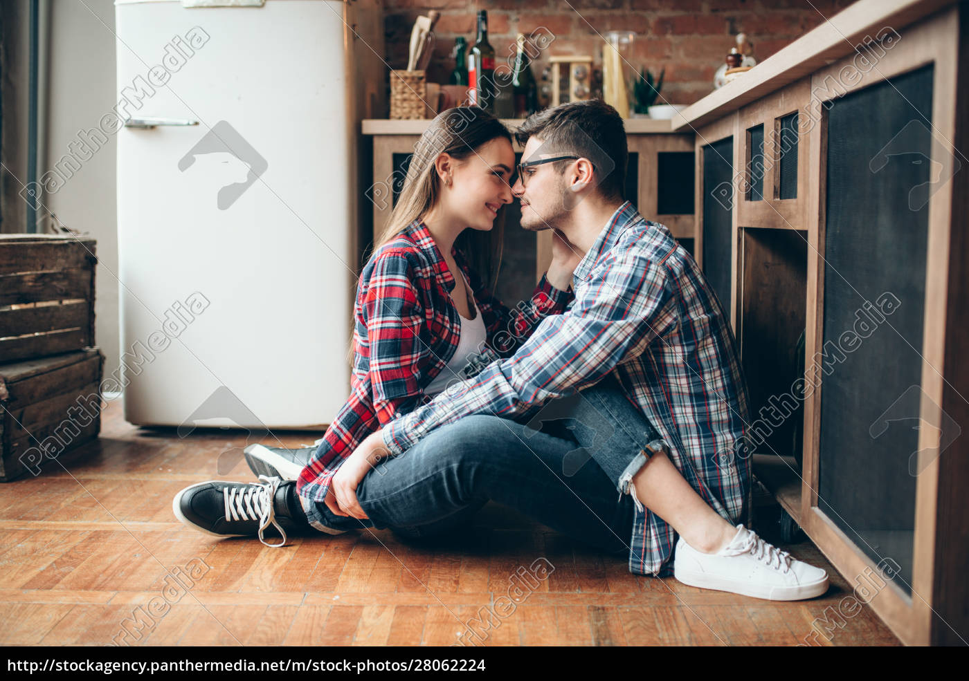 man, and, woman, sitting, on, kitchen - 28062224