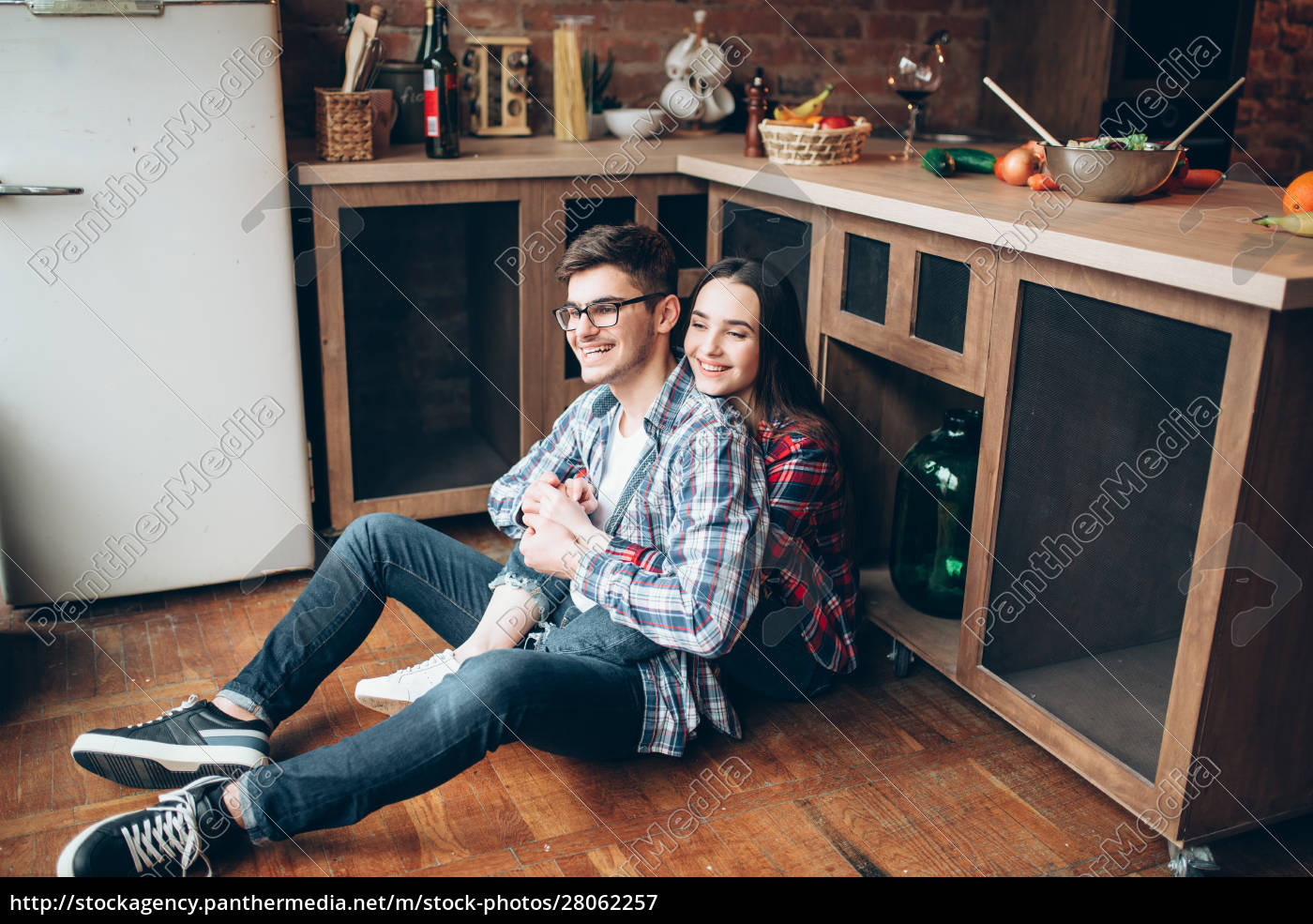 man, and, woman, sitting, on, kitchen - 28062257