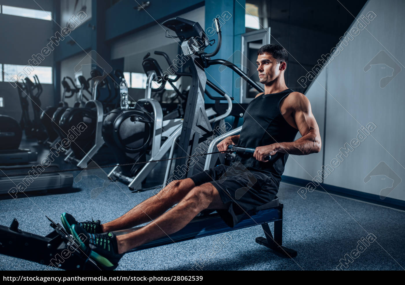muscular, man, workout, on, exercise, machine - 28062539