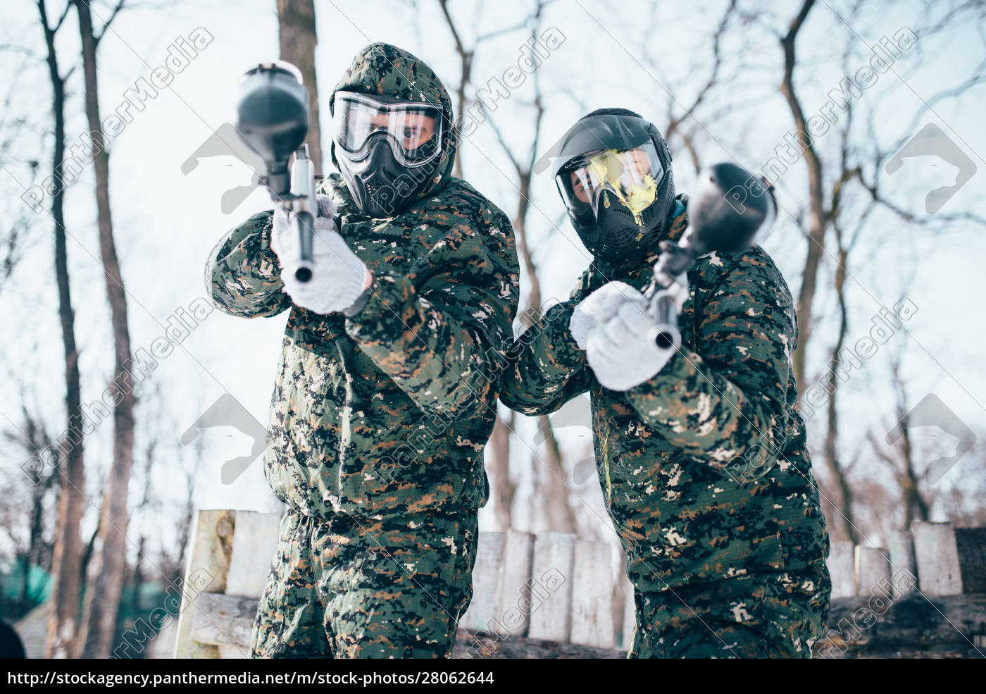 paintball, players, in, splattered, masks, after - 28062644