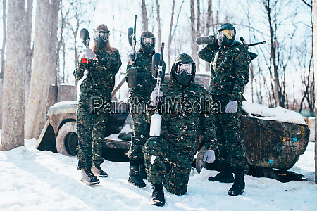 paintball, team, poses, with, marker, guns - 28062802