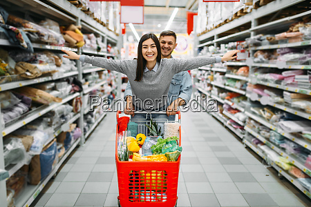 playful, couple, with, cart, full, of - 28062854