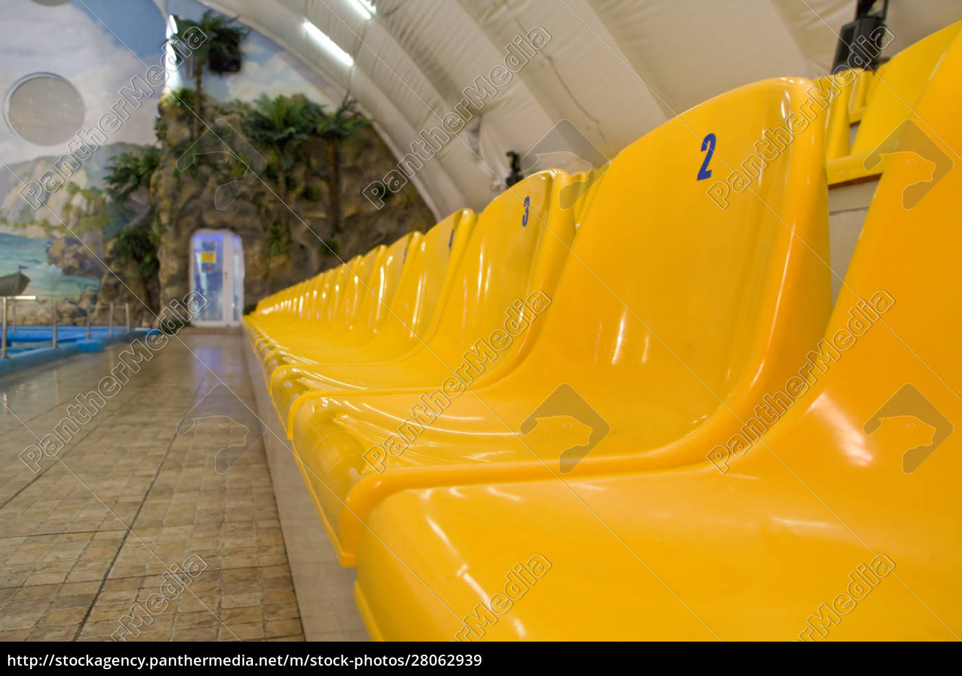 rows, of, yellow, seats - 28062939